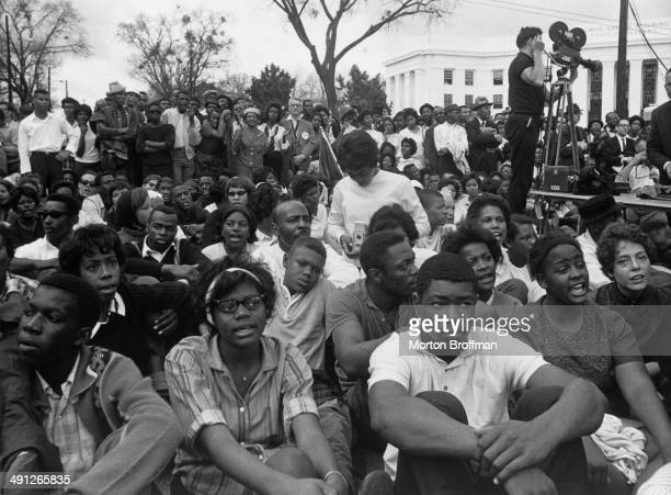 Students from the Tuskegee Institute listen to speeches at the conclusion of the Selma to Montgomery march March 1965