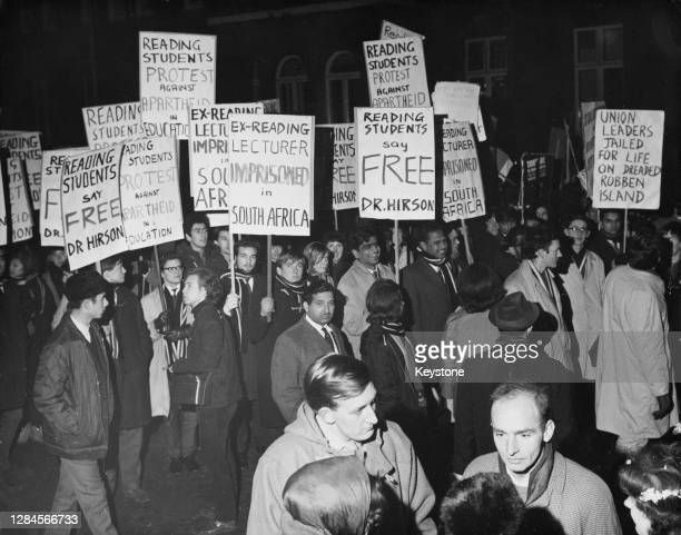 Students from the University of Reading carrying banners and placards join around 5,000 protestors on a rally against apartheid, marching four miles...