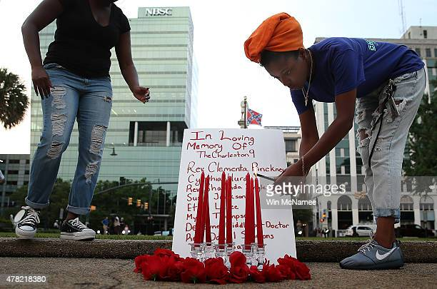 Students from the University of South Carolina and South Carolina State University light candles before a moment of silence for the nine victims of...