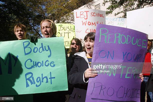 Students from the University of Texas hold signs during a rally in favor of abortion rights November 242003 in Austin Texas The rally was organized...