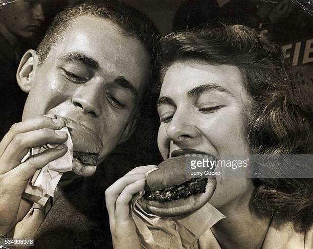 Students from the University of West Virginia enjoy eating hamburgers at a student hangout in Morgantown West Virginia