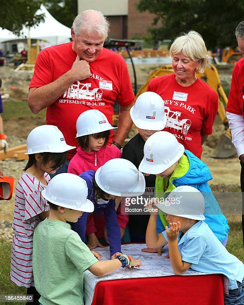 Students from the Winn Brook Elementary School with blueprints for the playground they helped design stand in front of Joe and Kathy O'Donnell at the...