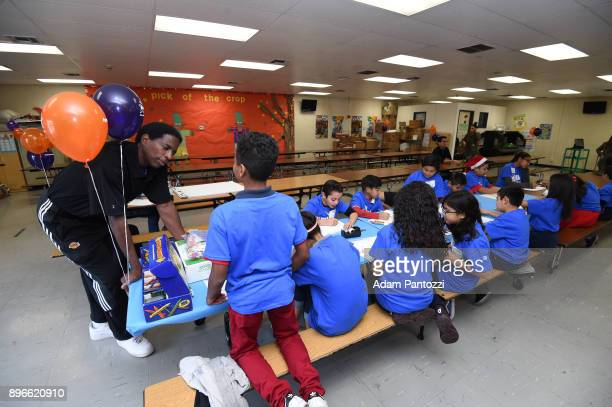 Students from Thomas Jefferson Elementary School WNBA Player Essence Carson and former NBA Player AC Green participate in Design Day with KaBOOM on...