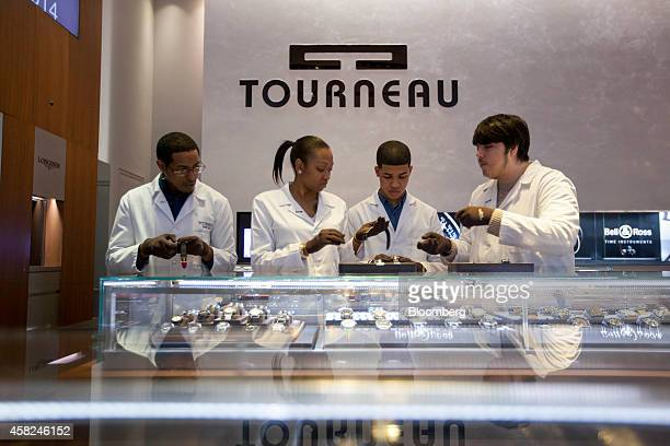Students from Tourneau Inc's Watchmaker Program Erick Vizciano from left Di Asia Carthon Nandy Gonzalez and Kevin Gonzalez reset watches ahead of...
