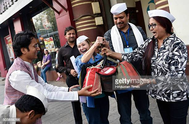 Students from USA checking tiffin boxes during the second sorting as they spend a day with the Mumbai Dabbawalas trying to decode their delivery...