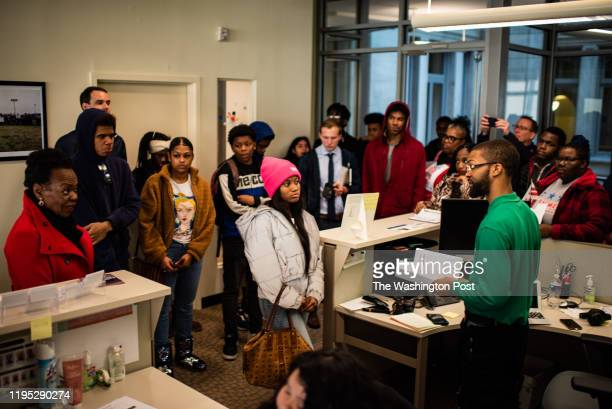 Students from Washington Metropolitan High, an alternative school, hand their petitions to a staff at the mayor's office at the John Wilson Building...