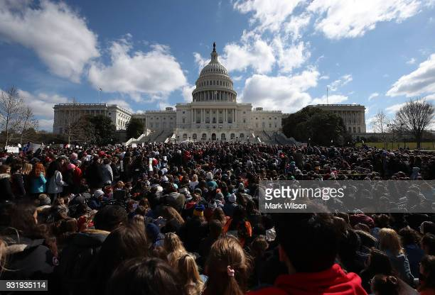 Students from Washingtonarea schools gather during a rally at the US Capitol to urge Congress to take action against gun violence on March 14 2018 on...