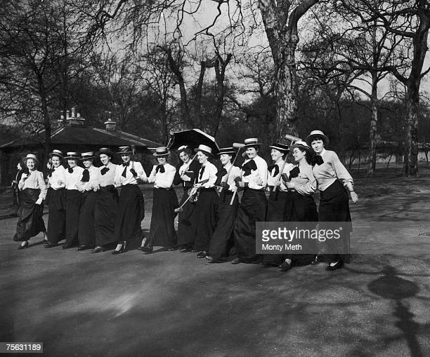 Students from Westfield College, Hampstead, in period dress, walking in Hyde Park, London, before taking part in a pageant organized by London...