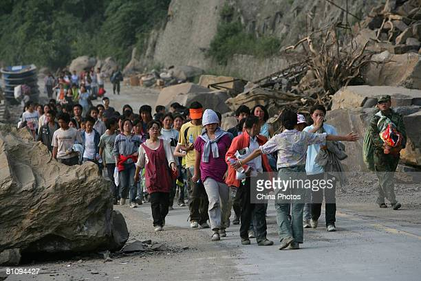 Students from Yingxiu Township High School who rescued from earthquake walk at the Zipingpu Dam after six hours hard journey on May 15 2008 in...