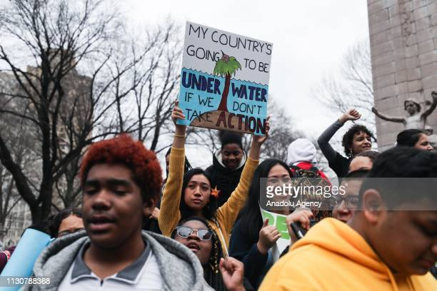 Students gather and take part in a demonstration to get people's attention for global climate change at Columbus Circle in New York United States on...