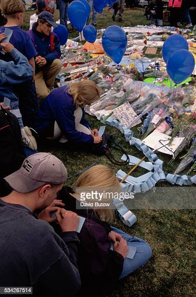Students gather at a makeshift memorial created for the victims of the Columbine shooting In May of 1999 students Eric Harris and Dylan Klebold...