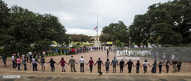 Students gather at a prayer vigil for Alton Sterling at the Memorial Tower on the Louisiana State University campus July 11 2016 in Baton Rouge...