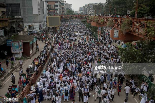 Students gather at Elephant Road Circle beside Dhaka College demanding road safety and justice for the traffic deaths in Dhaka Bangladesh on August 4...