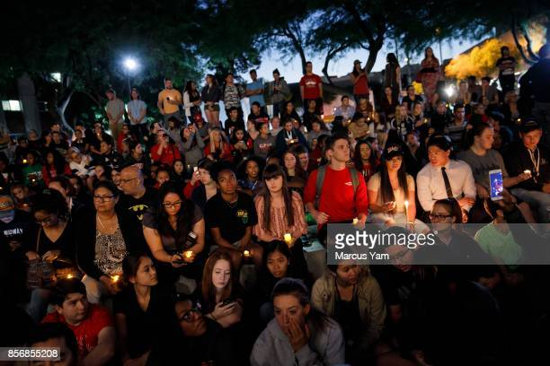 UNLV students gather for a candle light vigil for the victims of the mass shootings that killed 59 people and injured more than 525 in Las Vegas...