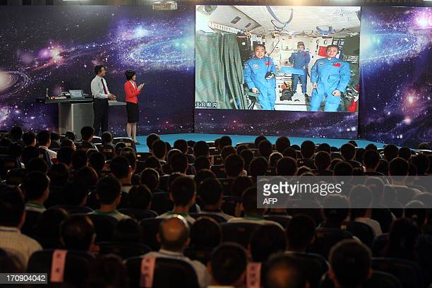 Students gather in a school in Beijing as Chinese female astrounaut Wang Yaping and her two companions give them a live lesson from Tiangong1 space...