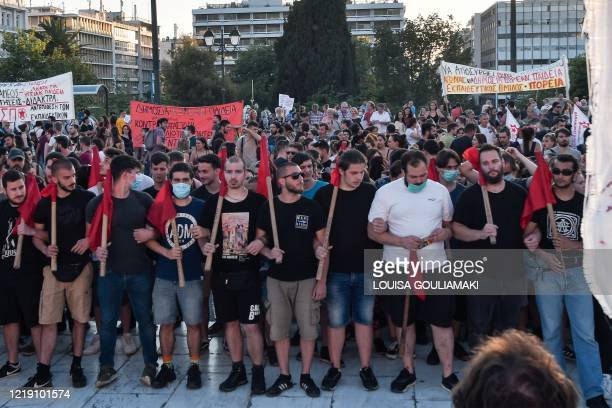 Students gather in front of the Greek Parliament in Athens on June 10 during a protest against the voting of an education reform bill, which includes...