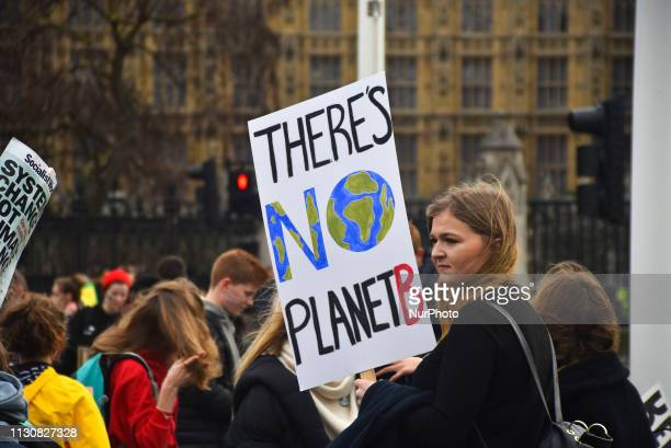 Students gather in Parliament Square holding placarda and shouting slogans against climate change London on March 15 2019