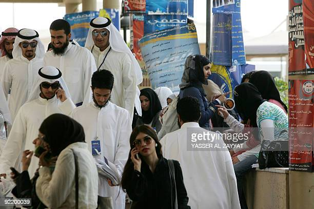 Students gather on campus at Kuwait University after voting in student union elections at the faculty of engineering and petroleum on October 22 2009...