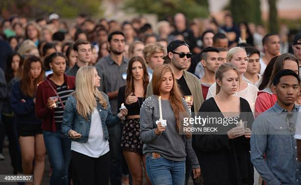 Students gathered for a candlelight vigil on the University of California Santa Barbara campus May 24, 2014 to remember those killed Friday night...