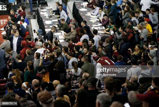 Students get into position to storm the court during a game between the Boston College Eagles and the Duke University Blue Devils on December 9 at...