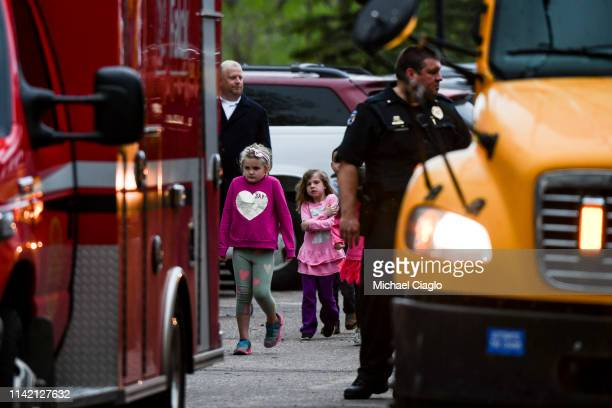 Students get off buses after being evacuated to the Recreation Center at Northridge after at least seven students were injured during a shooting at...
