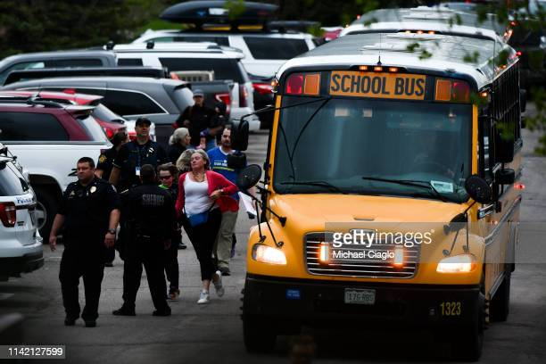 Students get off busses after being evacuated to the Recreation Center at Northridge after at least seven students were injured during a shooting at...