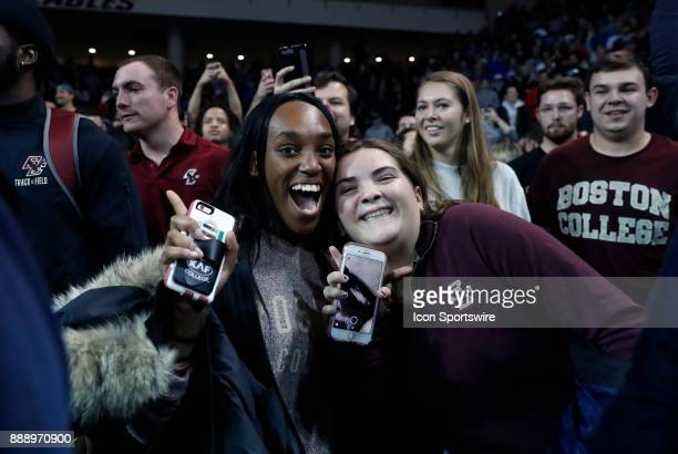 BC students get their phones ready to record the storming of the court during a game between the Boston College Eagles and the Duke University Blue...
