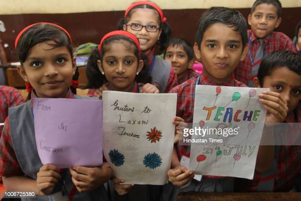 Students give roses to their teachers on the occasion of Guru Purnima at Bhrahman shikshan Mandal school on July 27 2018 in Mumbai India Guru Purnima...