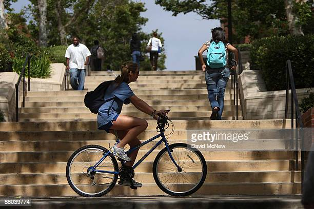 Students go about their business at University of California Los Angeles as the prospect of billions of dollars in cuts looms for California after...