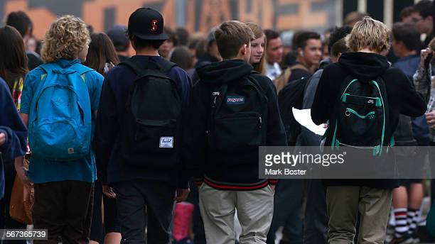 Students go about their daily business at Huntington Beach High School after being warned that one person on campus was diagnosed with measles...