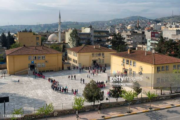 students going to classrooms after morning cereminy in a school,sanliurfa - emreturanphoto stock pictures, royalty-free photos & images