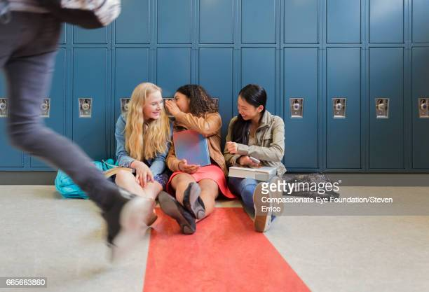 students gossiping in school hallway by lockers - rumor stock pictures, royalty-free photos & images