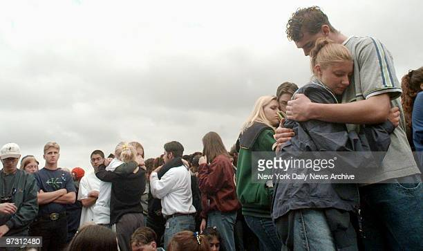 Students grieve at memorial to victims at Columbine High School in Littleton Colo where two teenagers shot to death 12 students and a teacher before...