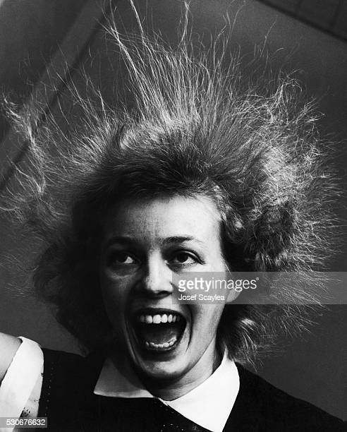 A student's hair goes frizzy and stands straight up during a static electricity experiment at the University of Washington 1955