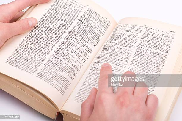 Student's hand pointing at a word