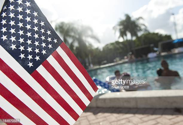 Students hang out at the campus swimming pool prior to the final presidential debate to be held at Lynn University in Boca Raton Florida on October...
