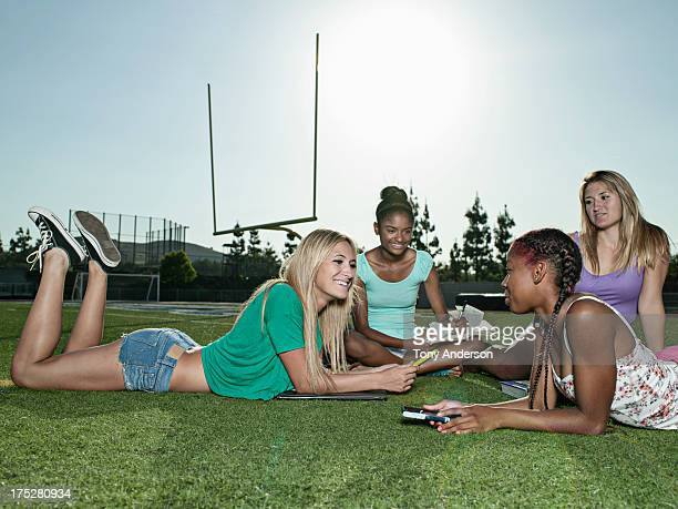 Students hanging out at sports field