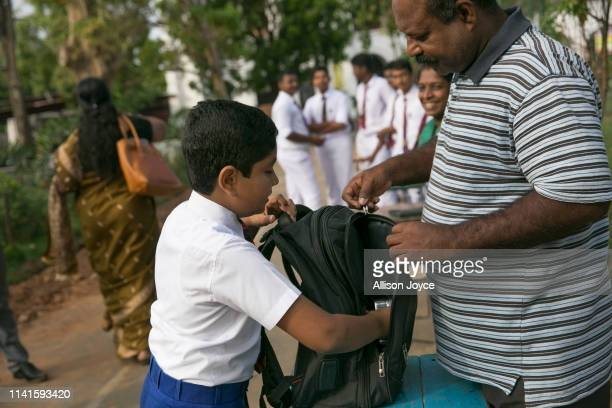 Students have their bags checked as they return to school as schools reopen across the country after the Easter attacks on May 6 2019 in Batticaloa...