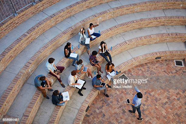 Students having class in outside auditorium