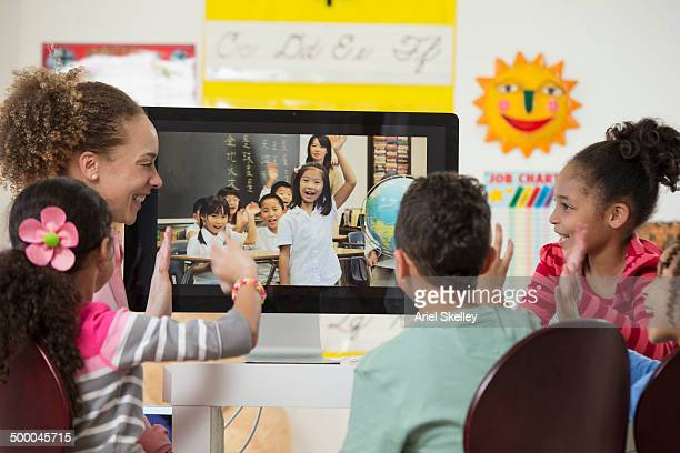 Students having teleconference with class in another country