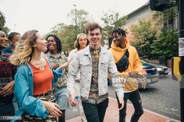 students heading to campus - graduation crowd stock pictures, royalty-free photos & images