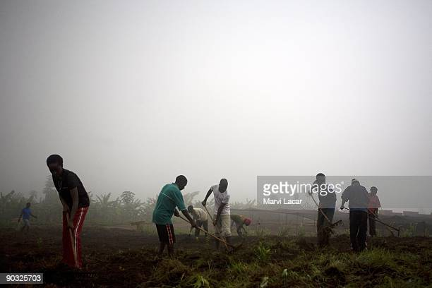 Students help till the land inside the Agahozo Shalom Youth Village on March 14 2009 in Rwamagana Rwanda The ASYV provides food shelter protection...