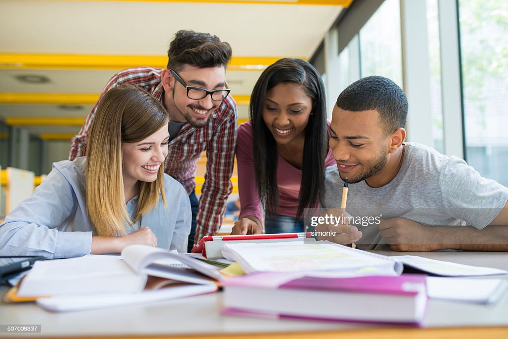 Students Helping Each Other : Stock Photo