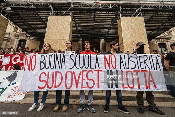 Students hold a banner reading 'No Good school no austeruty' during a national demonstration to protest against Italian Prime Minister Matteo Renzi's...