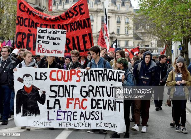 Students hold a banner reading 'Rubber baton hits are free of charge so should also the univeristy' as they joint a protest rally in Bordeaux...