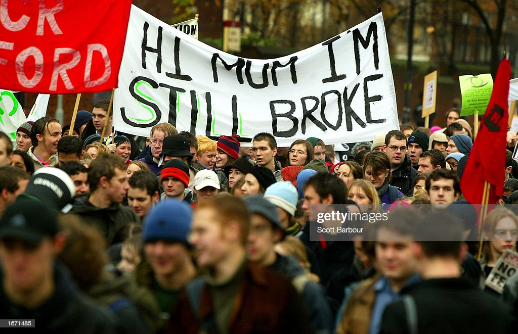 Students hold a banner with 'Hi Mum I'm still broke' written on it as they participate in a demonstration December 4, 2002 in London, England. Thousands of students marched through the streets of London to protest against student debt and any increase in fees.