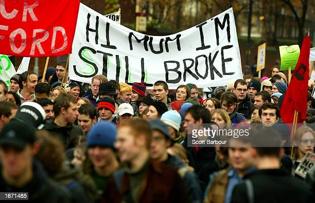 Students hold a banner with Hi Mum I'm still broke written on it as they participate in a demonstration December 4 2002 in London England Thousands...