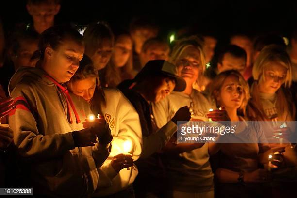 BOULDER COLO SEPTEMBER 20 2004 Students hold a candlelight vigil for L Gordon Bailey at the Dalton Trumbo Fountain Court in the University of...