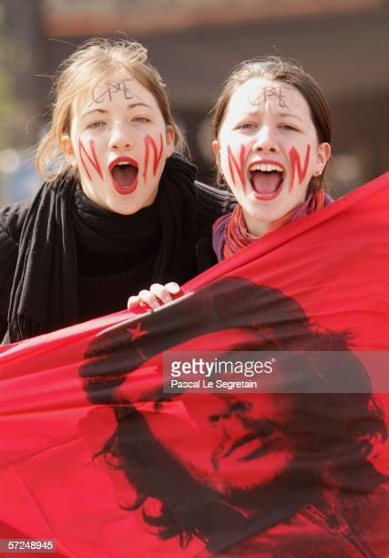 Students hold a Che Guevara flag during a large demonstration against the Youth Employment Contract April 4 2006 in Paris France Hundreds of students...