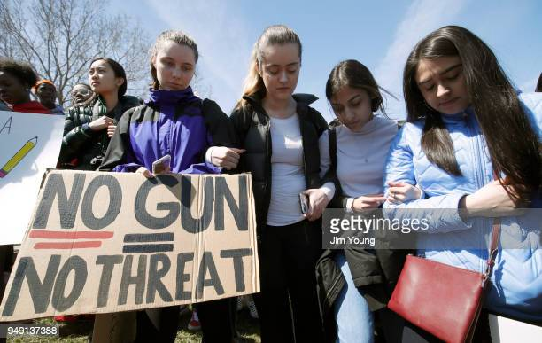 Students hold a moment of silence during a rally while taking part in National School Walkout Day to protest school violence on April 20, 2018 in...